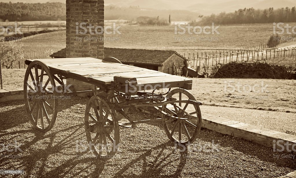 Old Wood Wagon In A Rustic Tuscany Farm At Sunset royalty-free stock photo