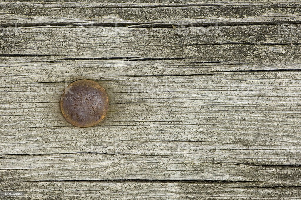 Old wood with iron nail royalty-free stock photo