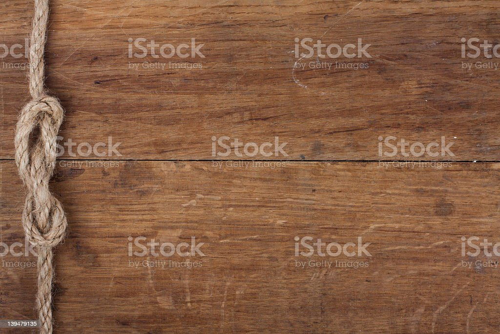 Old wood with rope knot background stock photo