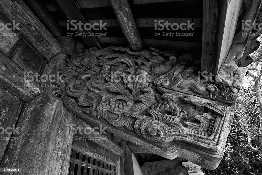 Old woodcarving in Quan Lan pagoda stock photo