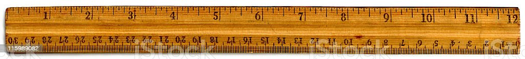 old wooden 12 inch ruler with inch and centimeter markings stock photo