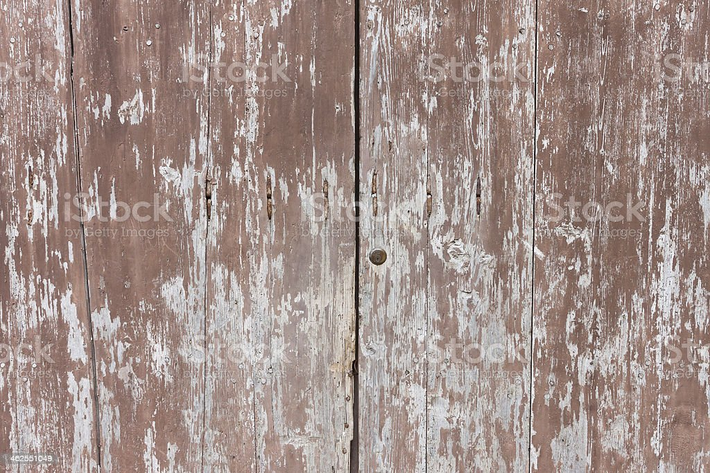 old wooden and grungy locked door stock photo