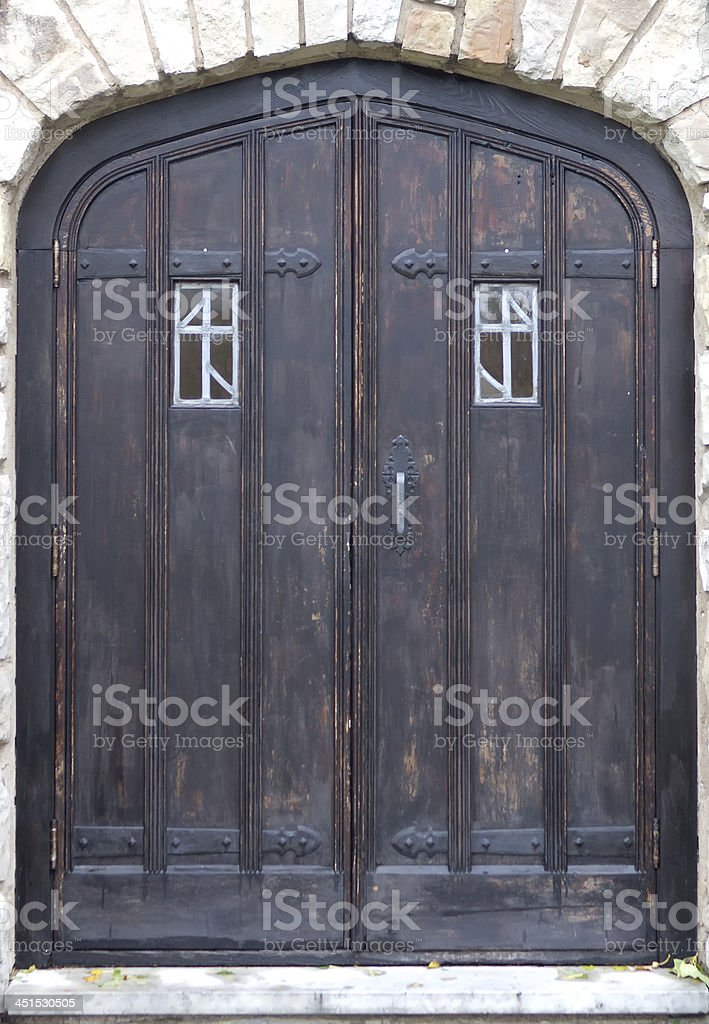 Old wooden and metal entrance door to a winery royalty-free stock photo