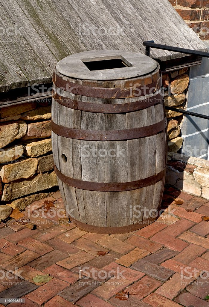 Old Wooden Barrel on a Brick Walkway royalty-free stock photo