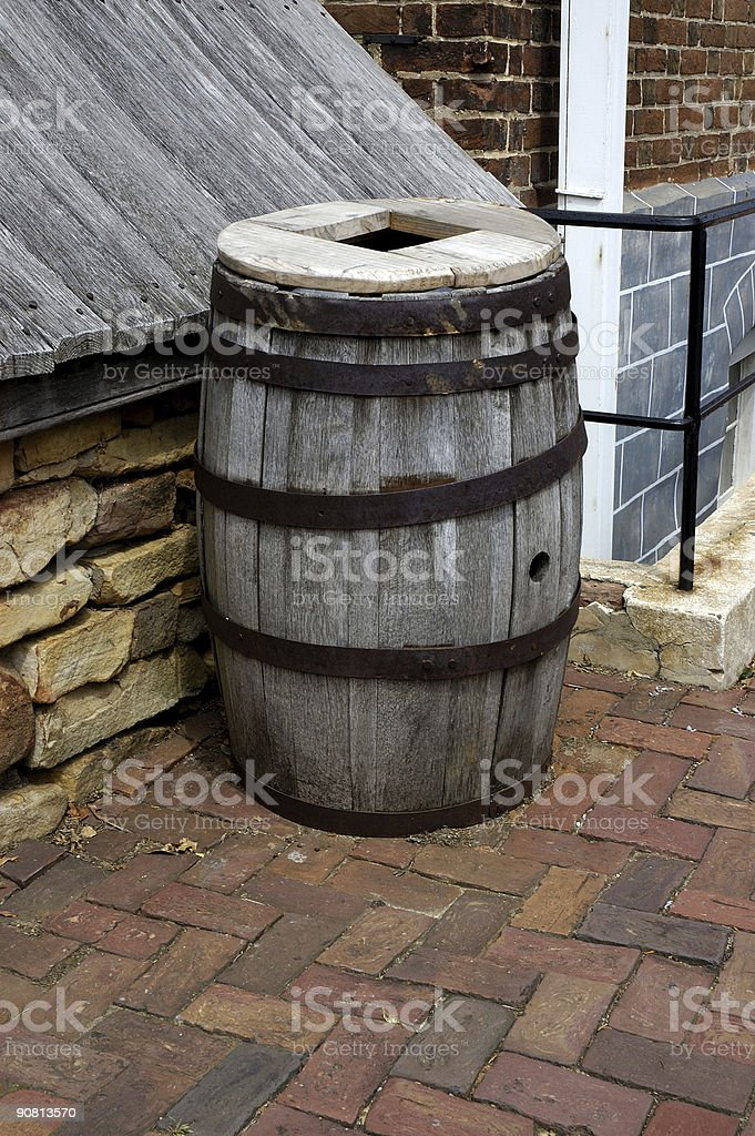 old wooden barrel on brick street royalty-free stock photo