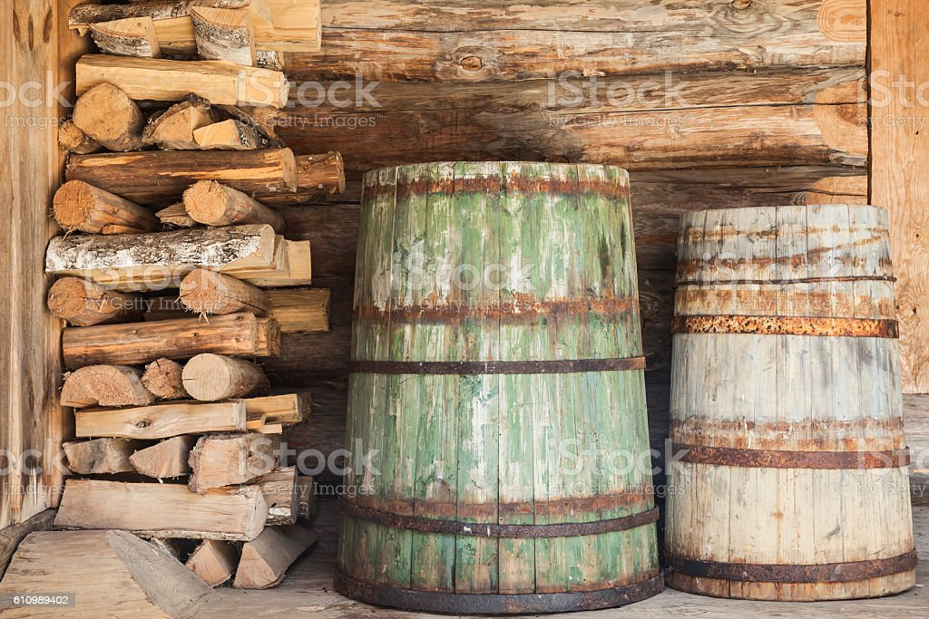 Old wooden barrels and firewood stock photo
