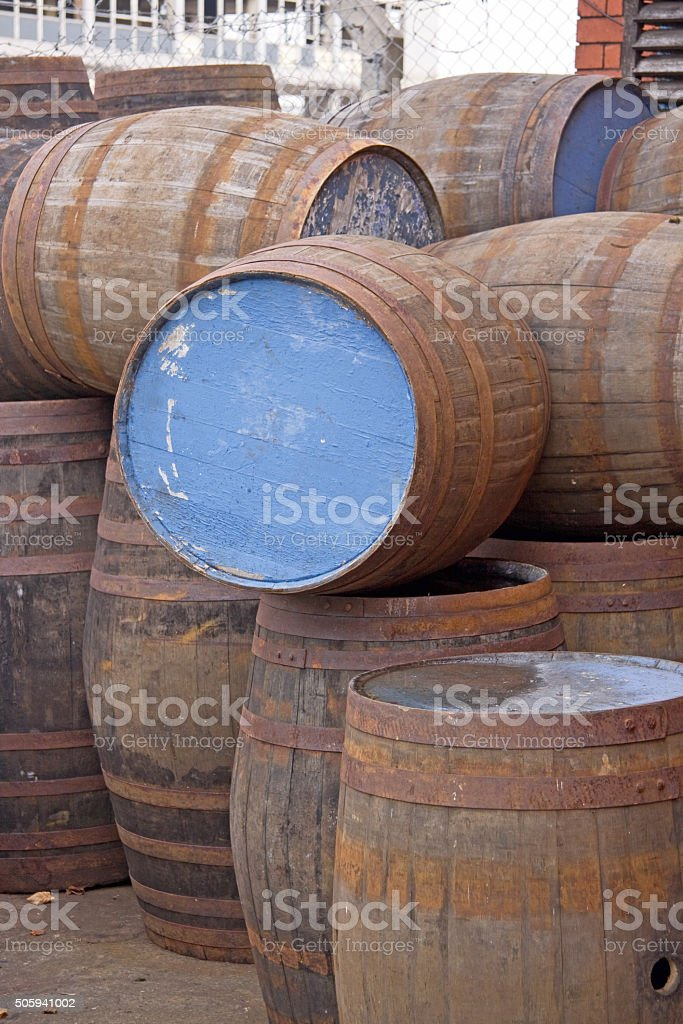 Old wooden barrels stacked in a yard in Bristol UK stock photo