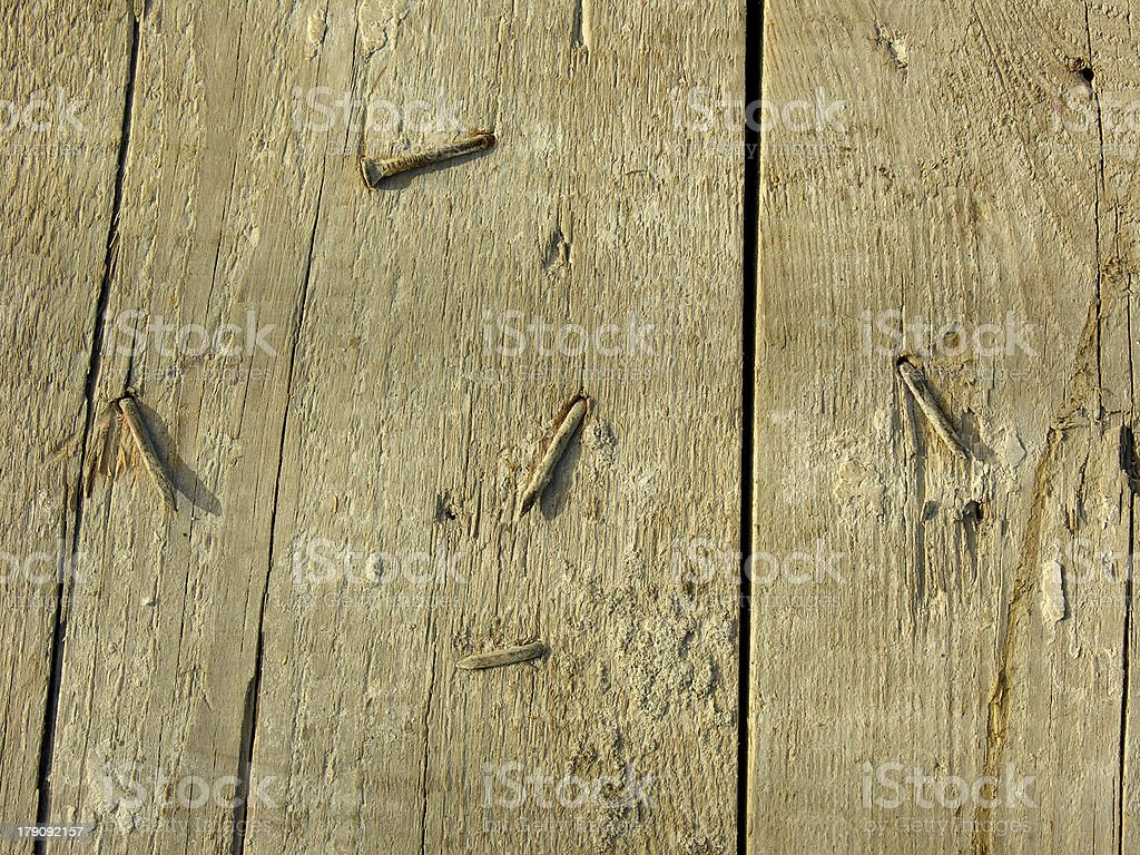 Old wooden board with rusted nails royalty-free stock photo