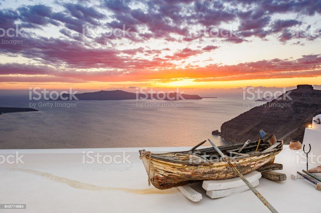 Old wooden boat on roof in Firostefani, Santorini island, Greece stock photo