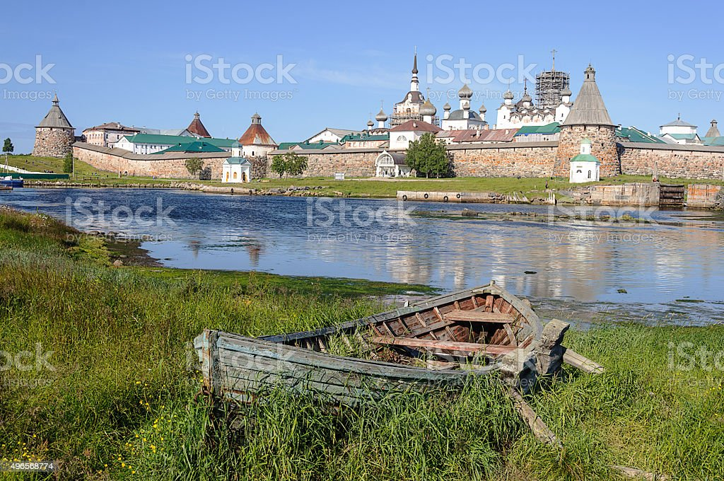 Old wooden boat on the backfround of Solovetsky monastery stock photo