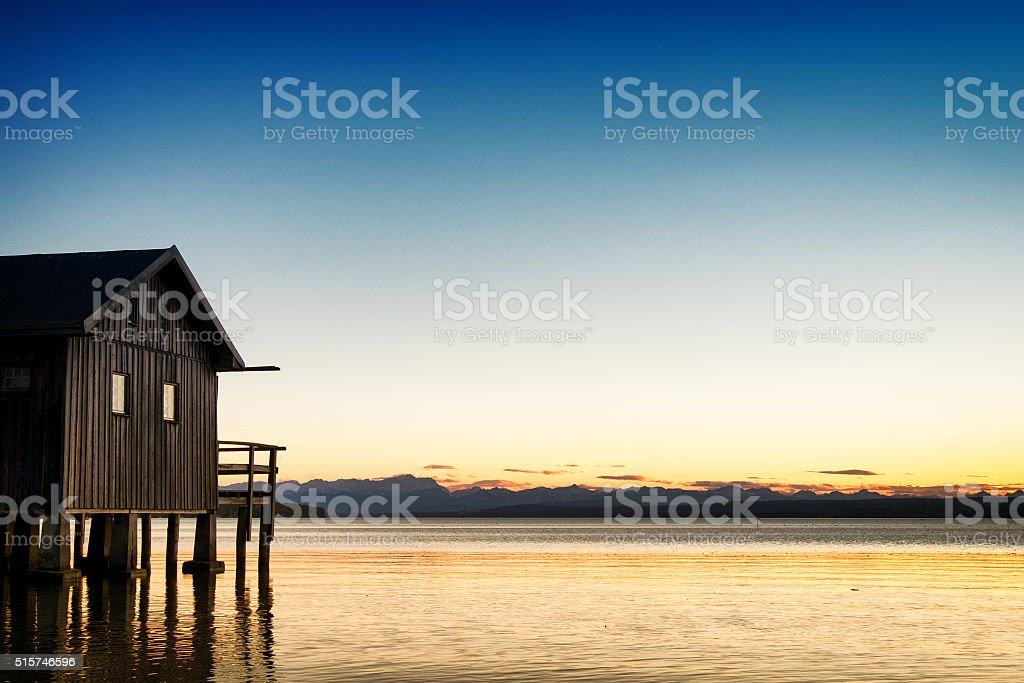 old wooden boathouse stock photo