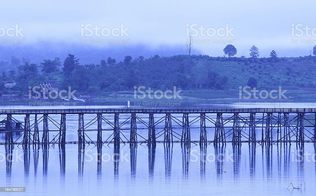 old wooden bridge across river in the morning. royalty-free stock photo