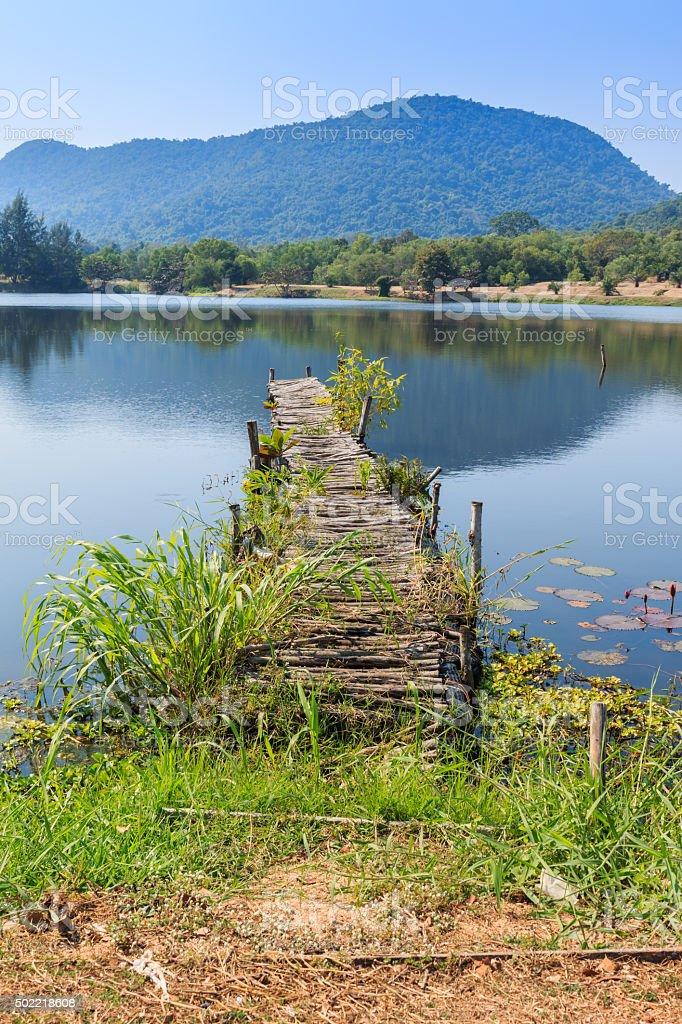 Old Wooden bridge along the lake stock photo