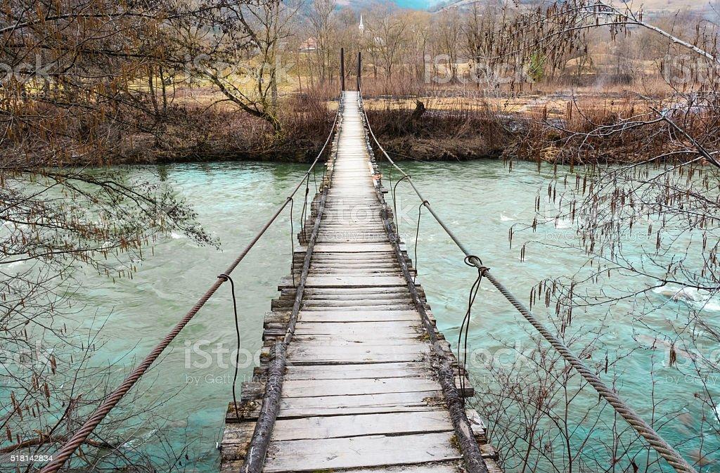 Old wooden bridge over river stock photo