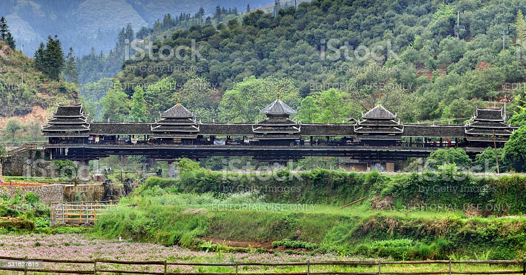 Old wooden bridge with a roof and walls, Guangxi, China. stock photo