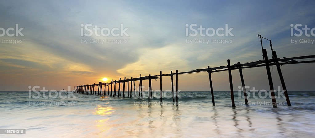 Old wooden bridge with sunset stock photo
