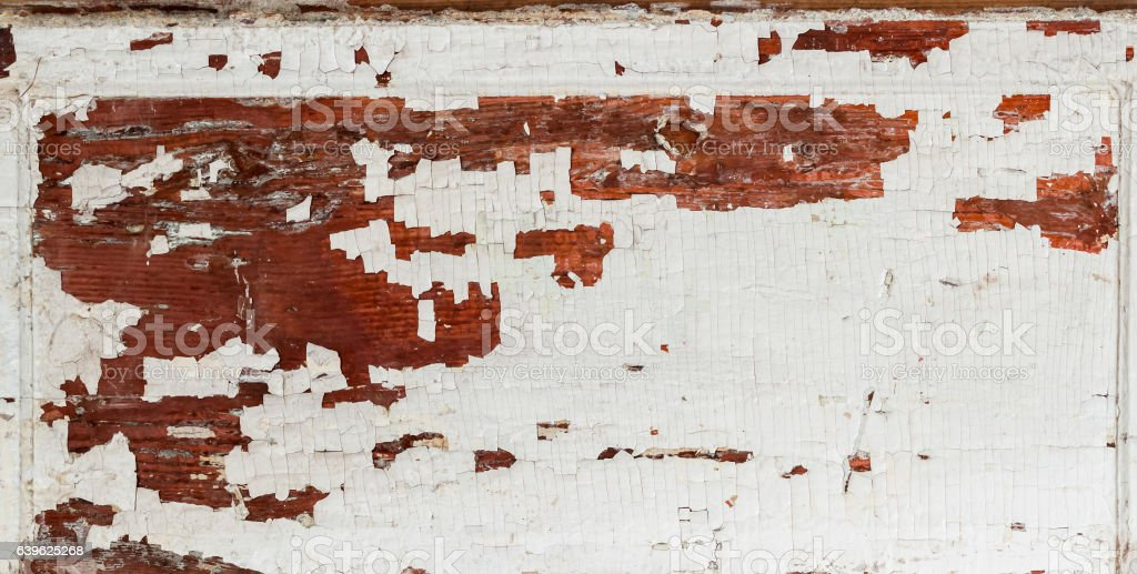 Old wooden brown textured background with peeling paint white color stock photo
