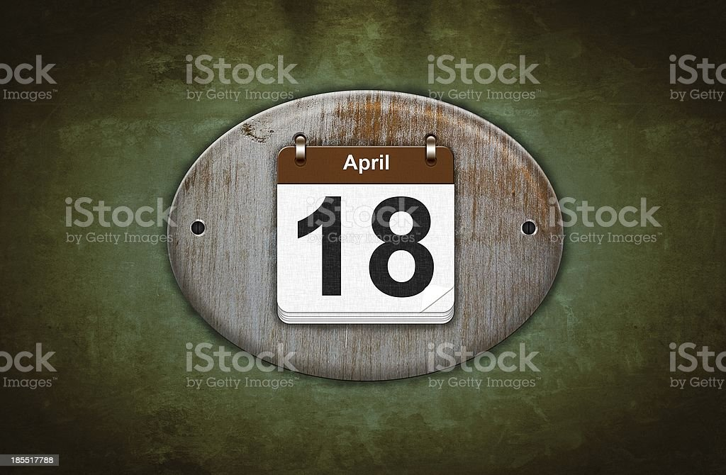 Old wooden calendar with April 18. royalty-free stock photo