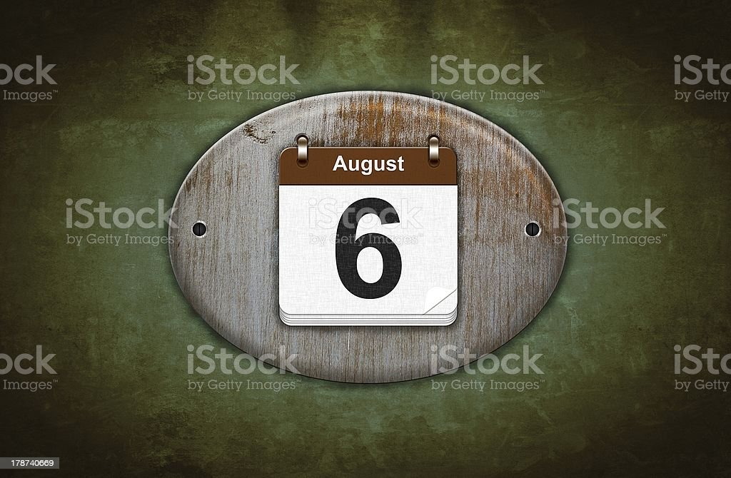 Old wooden calendar with August 6. royalty-free stock photo