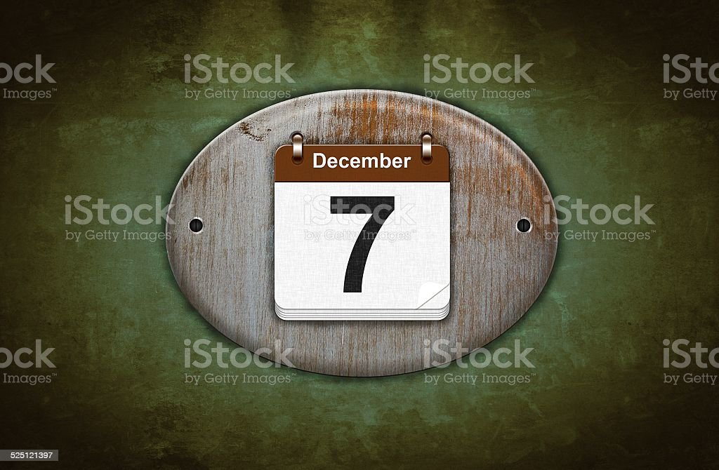 Old wooden calendar with December 7. stock photo