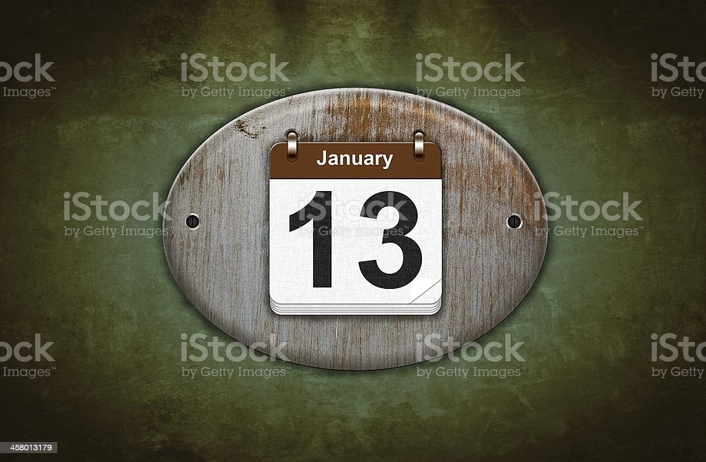 Old wooden calendar with January 13. royalty-free stock photo