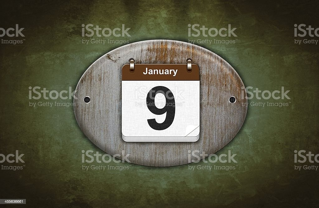 Old wooden calendar with January 9. stock photo