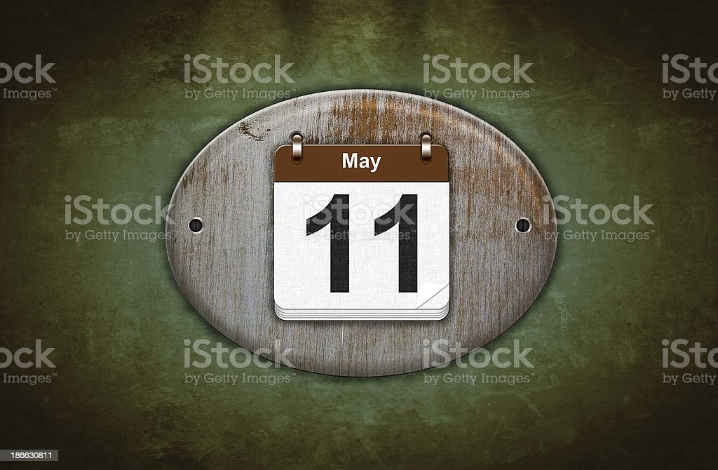 Old wooden calendar with May 11. royalty-free stock photo