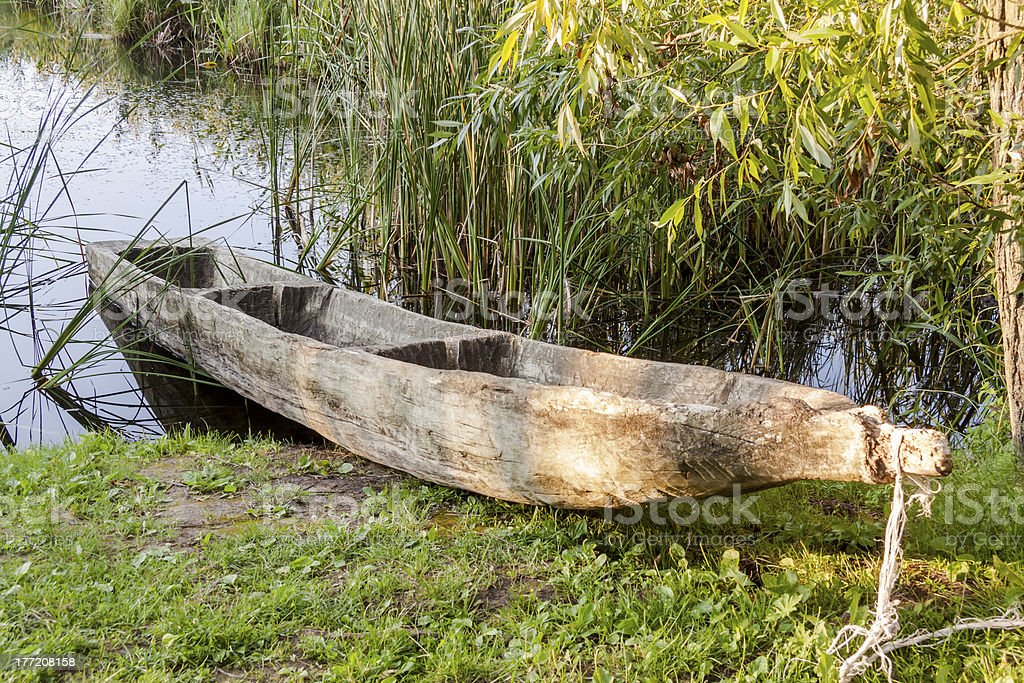 Old wooden canoe in Biskupin Museum - Poland. stock photo