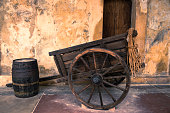 Old wooden cart and barrel.