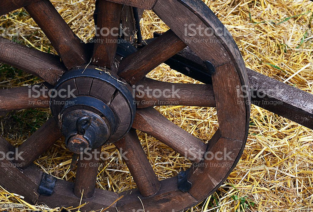 Old wooden cartwheel close up.Old wooden waggon dray weel. stock photo