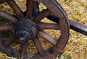 Old wooden cartwheel close up.Old wooden waggon dray weel.