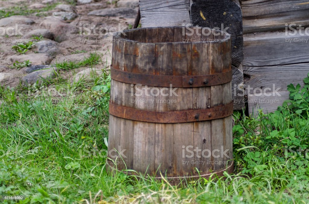 Old wooden cask at a farmhouse stock photo