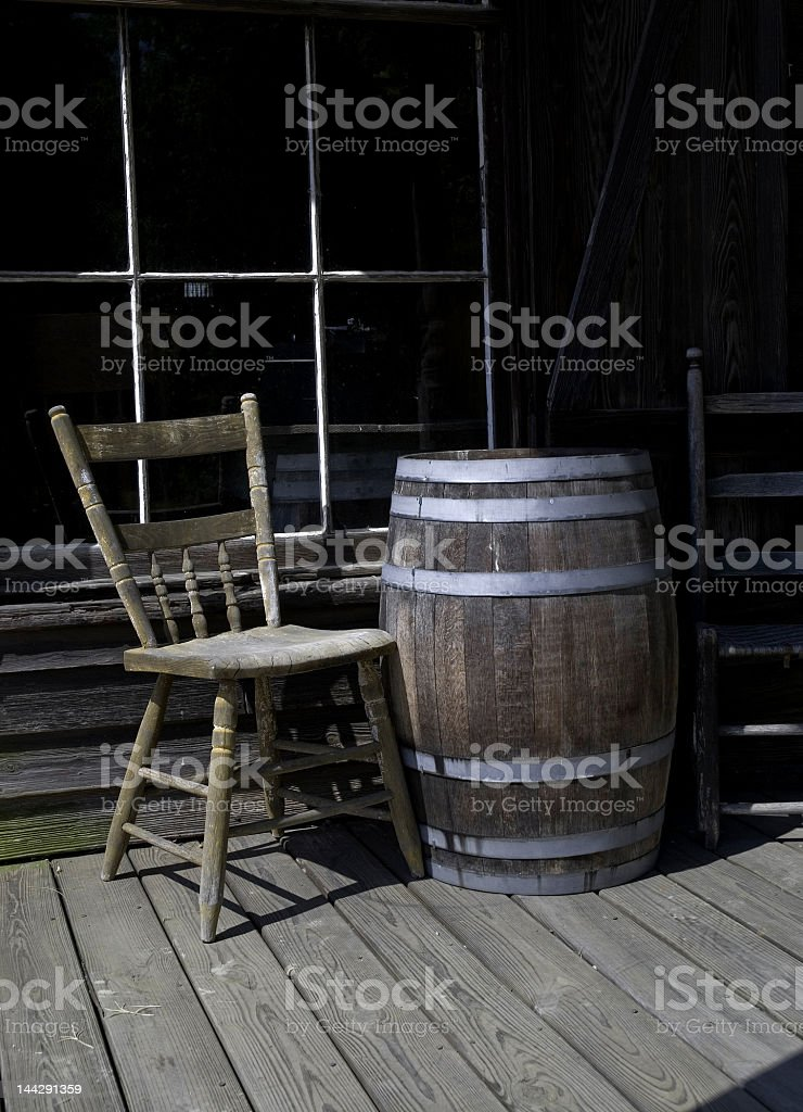 Old Wooden Chair and Barrel on a Porch royalty-free stock photo