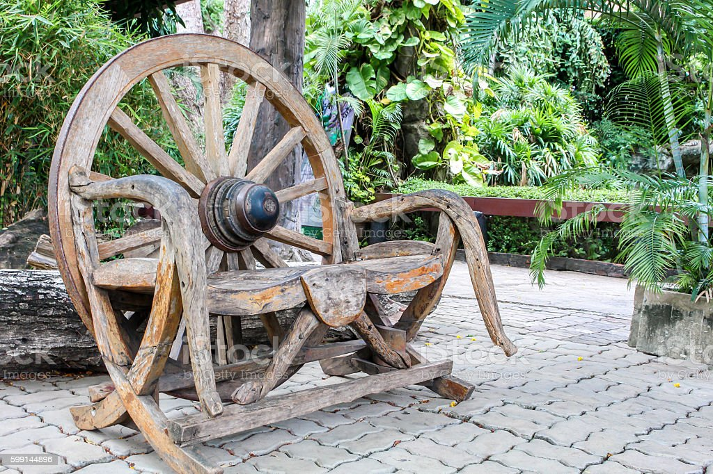 old wooden chair made of wood wheel stock photo