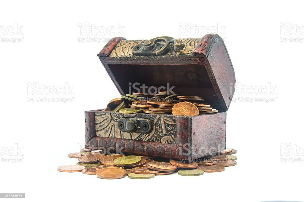 Old wooden chest with golden coins isolated stock photo