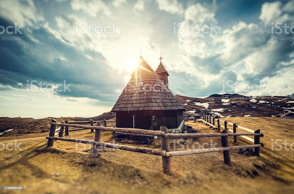 Old Wooden Church On Top Of The Hill At Sunset stock photo