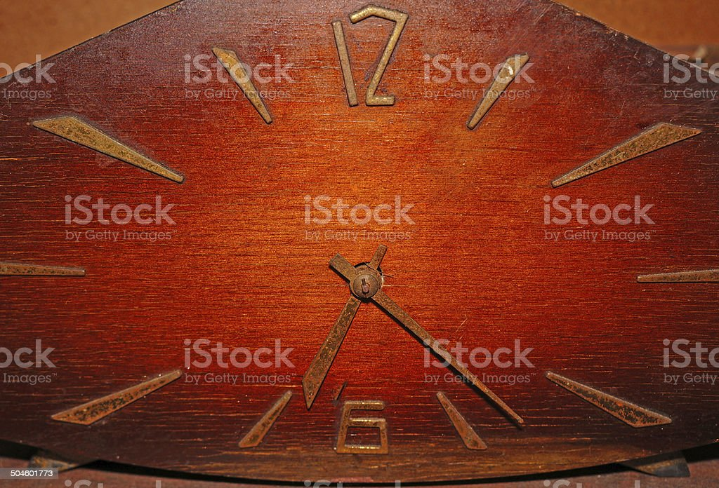 Old wooden clock with rusty arrows royalty-free stock photo