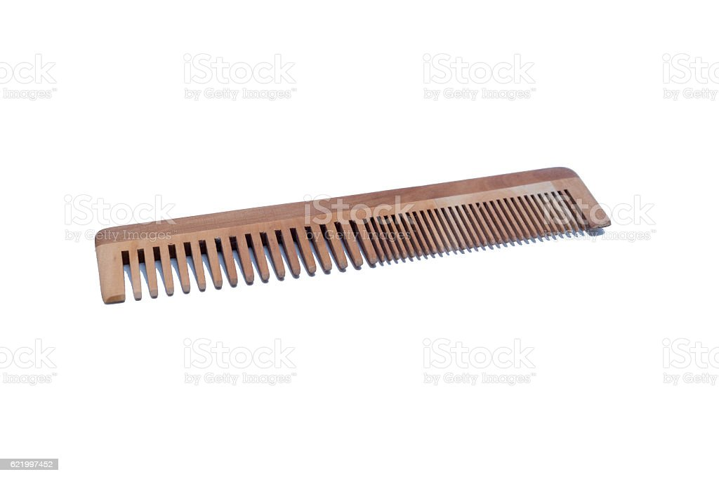 Old wooden comb hairbrush, isolated on white background stock photo