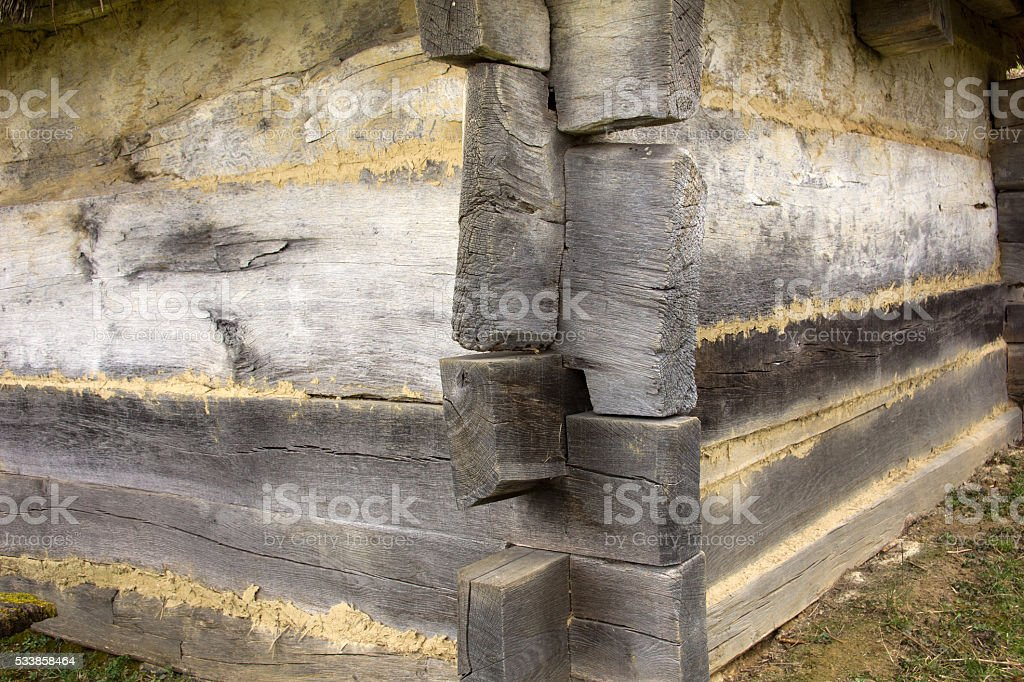 Old wooden corner construction stock photo