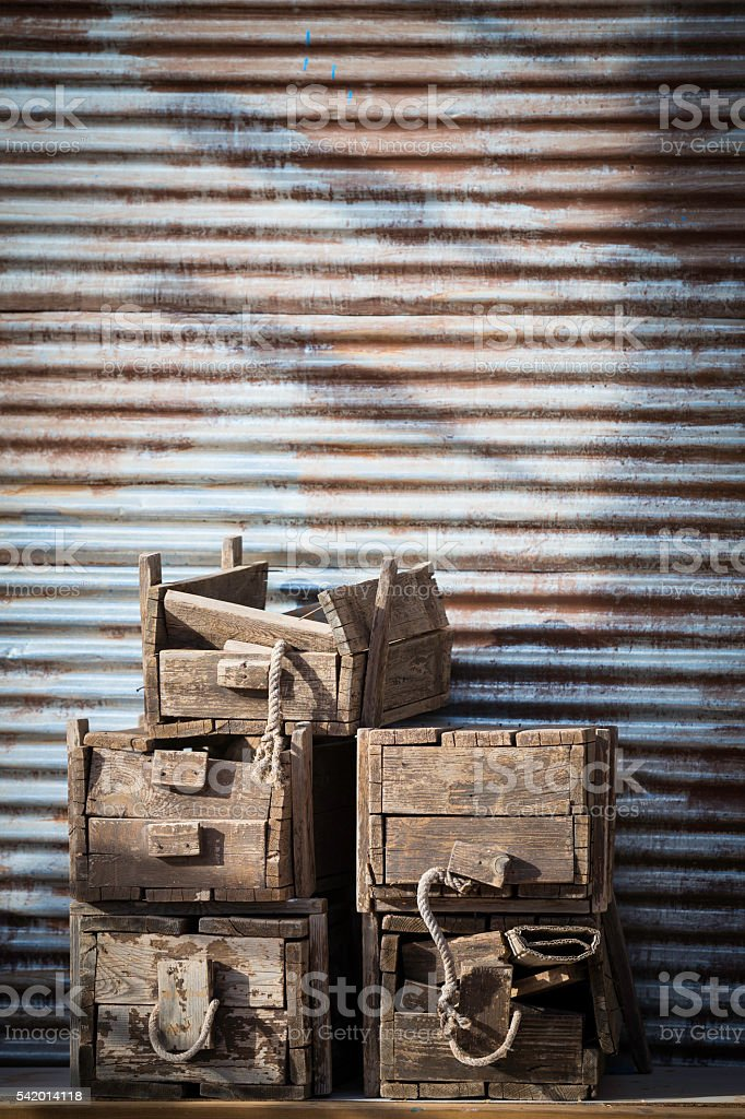 old wooden crates stacked stock photo