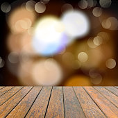 Old wooden deck table with a sparkling bokeh