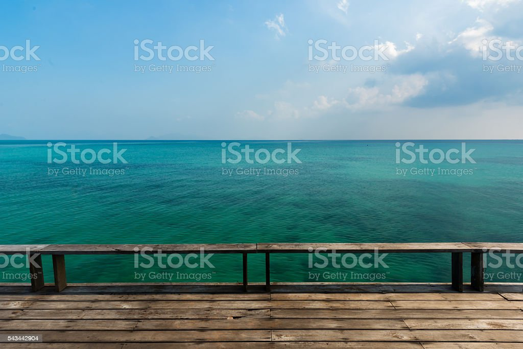 Old wooden deck with blue sea stock photo
