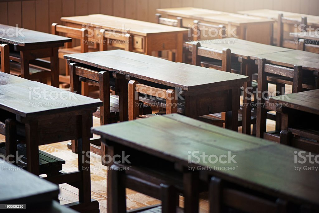 Old wooden desks stock photo