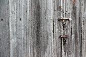 old  wooden door and rusty iron knocker