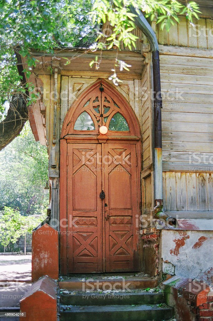 Old wooden door in gothic style stock photo