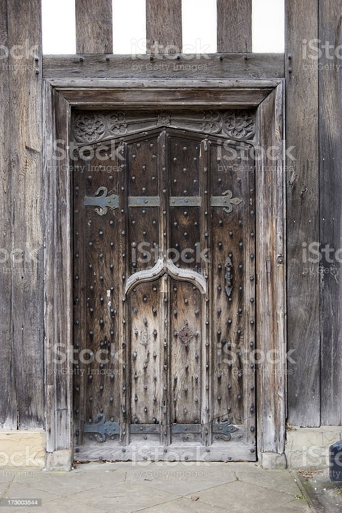 Old wooden door of Tudor building stock photo