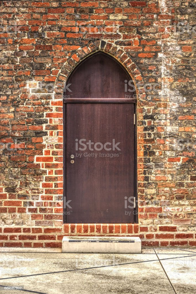 Old wooden door to church in Lubeck - Germany stock photo
