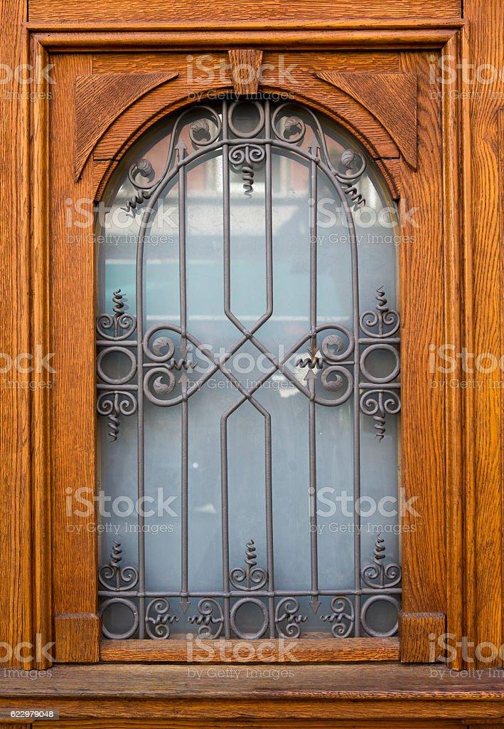 old wooden door with beautiful ironwork stock photo