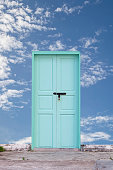old wooden door with blue sky background.