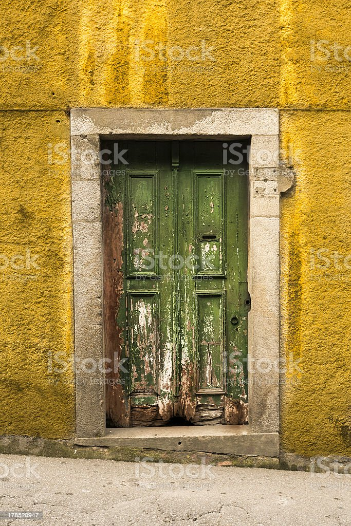 Old Wooden Door With Green Paint Flaking royalty-free stock photo
